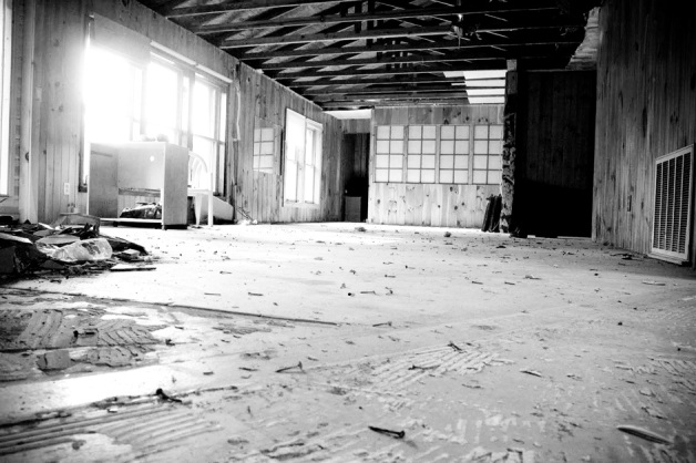 Black & white photo of a warehouse demolition for a remodel